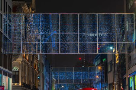LONDON - NOVEMBER 21, 2019: Christmas lights on Oxford Street in London feature 27 energy efficient LED light curtains draped over the length of the street, made up of 220,000 sparkling lights
