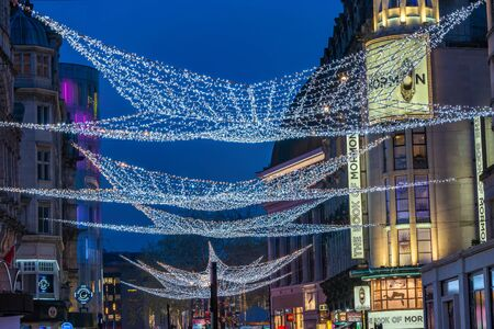 LONDON - NOVEMBER 21, 2019: Christmas lights on Londons Coventry Street attract thousands of shoppers during the festive season and are a major tourist attraction in London 報道画像