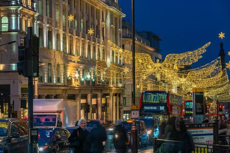LONDON - NOVEMBER 21, 2019: Christmas lights on Regents Street St James. Beautiful Christmas decorations attract thousands of shoppers during the festive season and are a major tourist attraction.