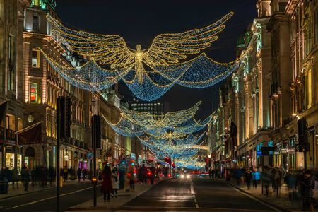 LONDON - NOVEMBER 21, 2019: Christmas lights on Regent Street, London, UK. The Christmas lights attract thousands of shoppers during the festive season and are a major tourist attraction in London 写真素材 - 136347144
