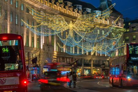 LONDON - NOVEMBER 21, 2019: Christmas lights on Regent Street, London, UK. The Christmas lights attract thousands of shoppers during the festive season and are a major tourist attraction in London 写真素材 - 136347148