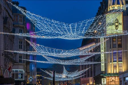 LONDON - NOVEMBER 21, 2019: Christmas lights on London's Coventry Street attract thousands of shoppers during the festive season and are a major tourist attraction in London 写真素材 - 136347149
