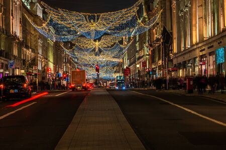 LONDON - NOVEMBER 21, 2019: Christmas lights on Regent Street, London, UK. The Christmas lights attract thousands of shoppers during the festive season and are a major tourist attraction in London 写真素材 - 136347150