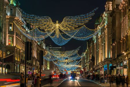 LONDON - NOVEMBER 21, 2019: Christmas lights on Regent Street, London, UK. The Christmas lights attract thousands of shoppers during the festive season and are a major tourist attraction in London 写真素材 - 136347152