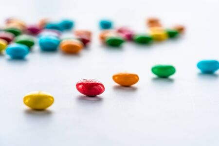 Colorful candy sweets on white background - closeup with selective focus