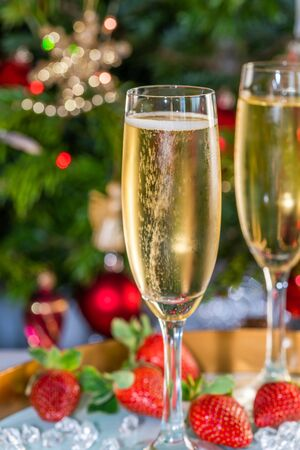 Champagne in glasses with strawberries on festive