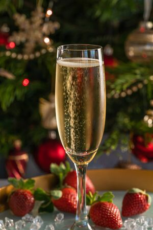 Champagne in glass with strawberries on festive 写真素材 - 136792726