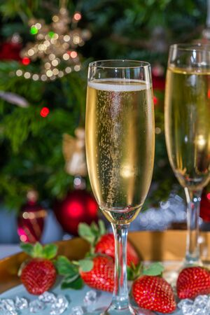 Champagne in glasses with strawberries on festive 写真素材 - 136792727