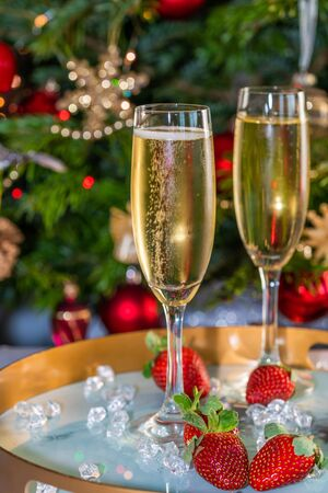 Champagne in glasses with strawberries on festive 写真素材 - 136792822