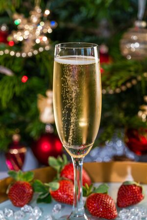 Champagne in glass with strawberries on festive 版權商用圖片