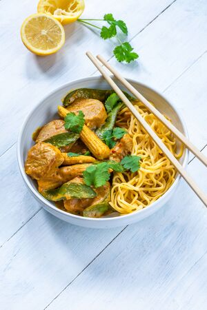 Satay pork curry with egg noodles Фото со стока - 137848047