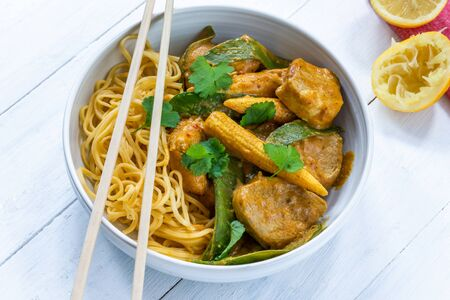 Satay pork curry with egg noodles Фото со стока