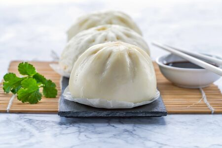 Chinese steamed buns with meat and vegetables Фото со стока