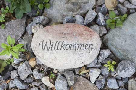 A welcome message written on a stone. photo