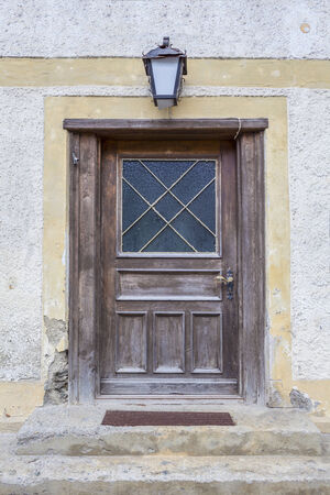 abandoned house: An old wooden door leading inside an old abandoned house