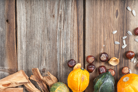 Different kinds of autumn fruits on a wooden table. photo