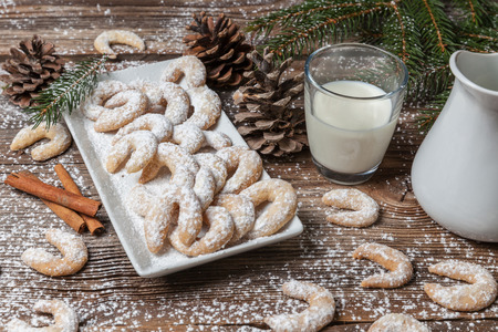 Vanille cookies and milk on a wooden table Stock Photo - 34597172
