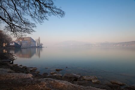 Schloss Kammer and Seewalchen on lake Attersee in wintertime with snow.