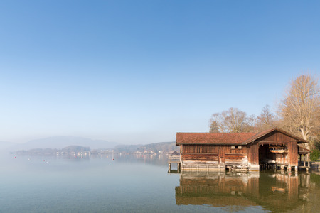 boathouse: A boathouse at lake Attersee in the morning. Stock Photo