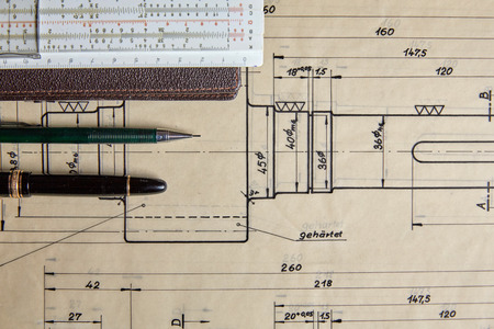 Old technical plan with ruler and pen on old wooden table Stock Photo