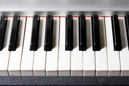 electronic piano: Piano keys on an old electronic piano