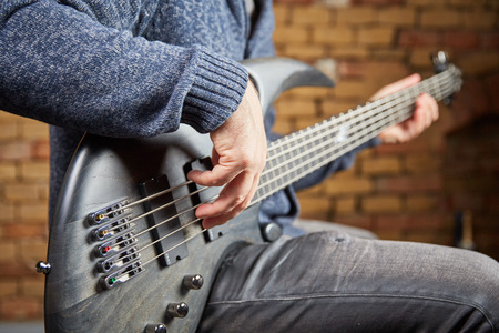 festival scales: man playing the bass guitar Stock Photo