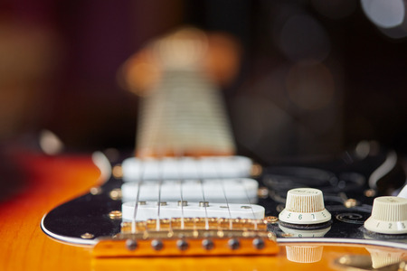 knobs: Detail of electric guitar with strings, pick-up and knobs