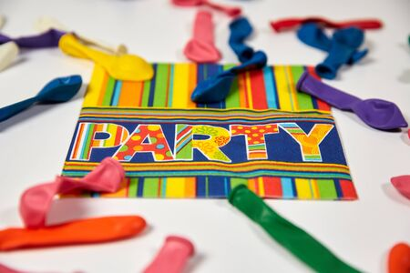 party streamers: Colored carnival streamers and napkin as colorful party decoration