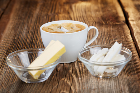 bullet proof: Coffee, butter and coconut oil for bulletproof coffee on a brown wooden table Stock Photo