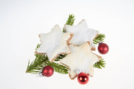 Christmas cookies and fir branch and red christmas balls ilsolated Stock Photo