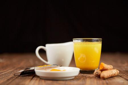 inflammatory: Golden milk turmeric tea with curcuma root and orange powder
