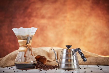 Brewign third wave coffee with chemex glass and drip kettle for pure flavor in good design on wooden table Stock Photo