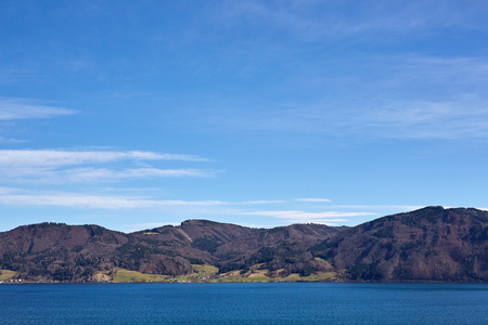 Lake Attersee and mountains under blue sky in spring at Nussdorf Stock Photo