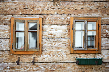 Old windows in antique house building wooden on retro background Stock Photo