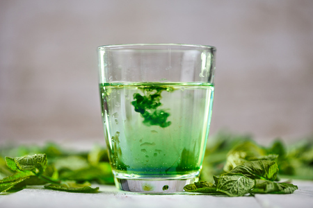 Chlorophyll detox drink with green mint on white table Stock Photo