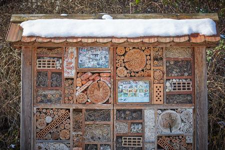 Insect hotel wood nature house box insektenhotel Stock Photo - 126310758