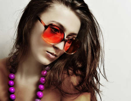 The girl in sunglasses and a beads photo