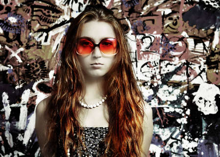 The girl in sun glasses and  beads photo