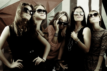 party dress: fashionable girls in sunglasses Stock Photo