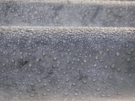 亜鉛の露滴クローズ アップ背景およびテクスチャの概要 写真素材
