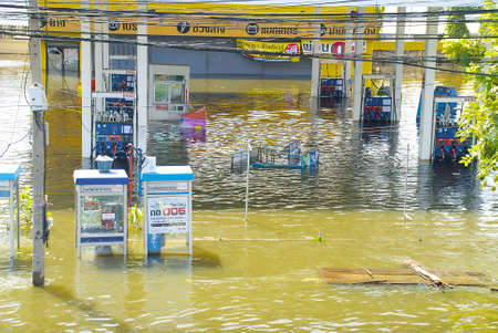 Pathum Thani, Thailand - October 27, 2011  Gas station submerged under flood waters near Bangkok, Thailand Heavy flooding in Thailand since July is slowly encroaching on the capital, Bangkok  Over 500 people have died as a result of the massive flooding