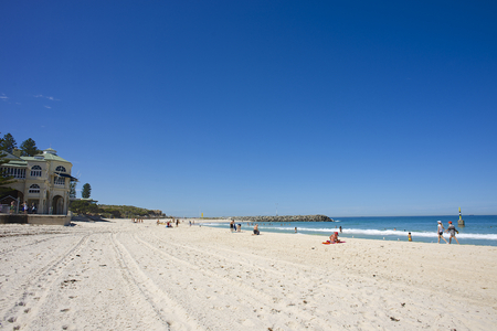 Cottesloe Beach in Perth, Western Australia, on a quiet summer day, with people enjoying the popular beach to escape the heat. Stock Photo