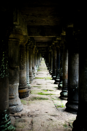 parallel world: Angkor, Cambodia: Parallel pillars underneath a walkway near Bayon Temple, part of the Angkor Temple world heritage site. Stock Photo