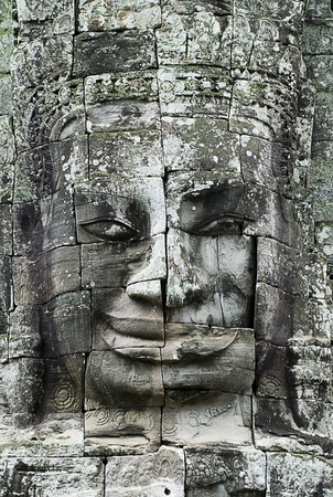 Siem Reap, Cambodia: Stone face at Bayon Temple. Bayon Temple is part of the Angkor