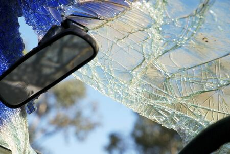 car on the road: Smashed Windshield Of A Car Wreck