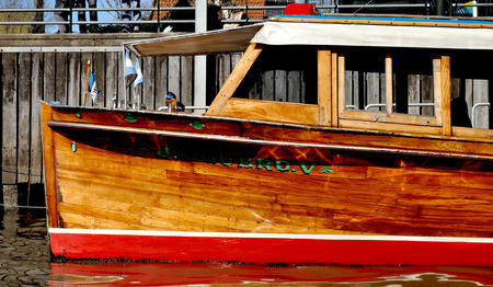 tigre: TIGRE, BUENOS AIRES, ARGENTINA - NOVEMBER 2016: Closeup of a typical wooden old water taxi motorboat in the port of the popular riverside resort El Tigre at the Parana Delta. Editorial