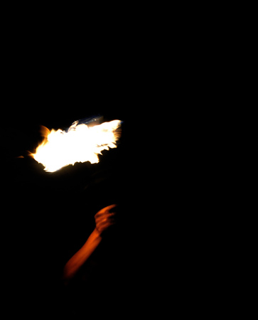 burning money: Man holding a fire torch in the dark night Stock Photo