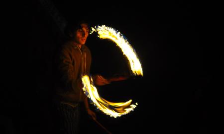 BANOS, ECUADOR - MARCH 25, 2016: A man perform Juggle with fire in Banos de Agua Santa, Tungurahua, Ecuador