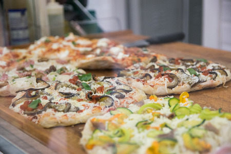 shopfront: italian pizza in the showcase of pizzeria in Florence, Italy Stock Photo