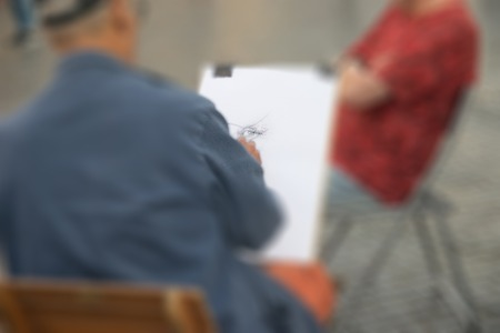 Artist drawing the eye of his model